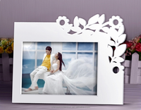 White carved wooden photo frame