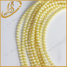 Wholesale round light golden original fresh water pearl strand