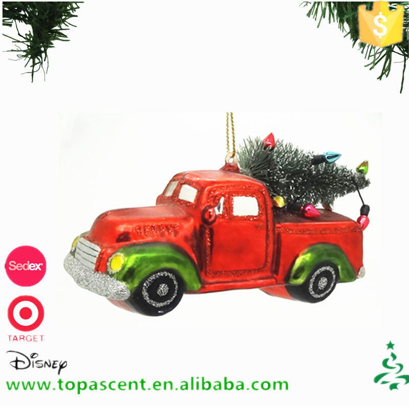China supplier selling hand blown glass truck carrring x'mas tree ornament for christmas decoration