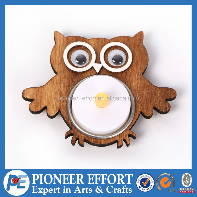 Wooden candle holder in decorative owl design