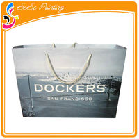 Printed custom made foldable boutique paper shopping bags