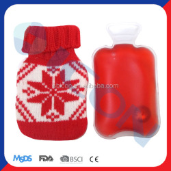 hand warmer with knitted hot water bottle with knitted cover