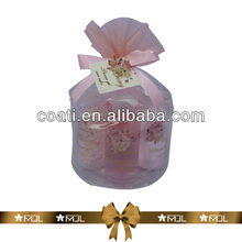 Name brand body lotion in organza pouch
