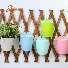 China Online Shopping Hanging Lazy Self Watering Half Round Flower Pot with Low Price