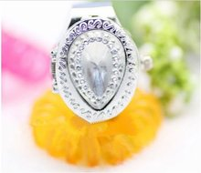 Tear-drop shape ladies ring watch with crystal on the face