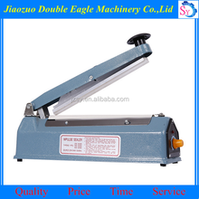 Small size commercial sealing machine price/rice bag sealing machine