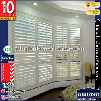 openable plantation shutter with wood color frame