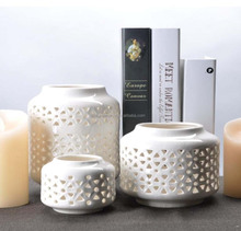Wholesales white round hollow-out glazed ceramic candle holder for home decoration