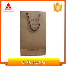 Wholesale best price customized design focus paper purse gift bags
