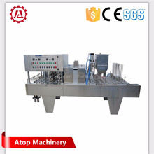 Automatic rotary yogurt cup filling sealing packing machine with precut lid in China