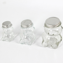 the bear shape glass candy jar with metal lid