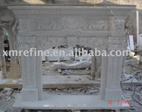 Polished white marble fireplace