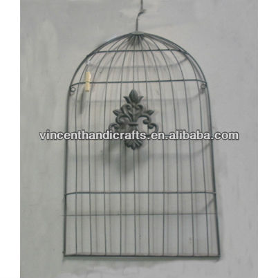 Rustic antique wall hanging metal wire birdcage decor.