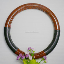 Wood grain and black leather steering wheel cover