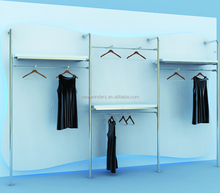 Wood slatwall panel and wall mounted clothing display with clothing metal rail