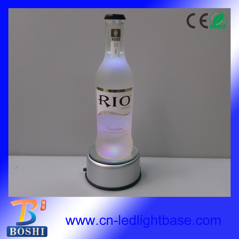 Silver mirror plastic base rotating led lighted bottle display