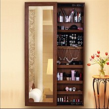 Space saver wall mounted sliding mirrored jewelry cabinet