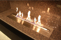 EcoSmart fireplace that made of stainless steel that hold a long burner that uses environmentally friendly bio-ethanol fuel