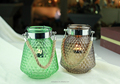 colored hanging glass candle holder with metal or jute handle