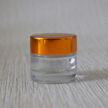 Empty cosmetic cream 10 g mini glass jar clear with gold srew caps