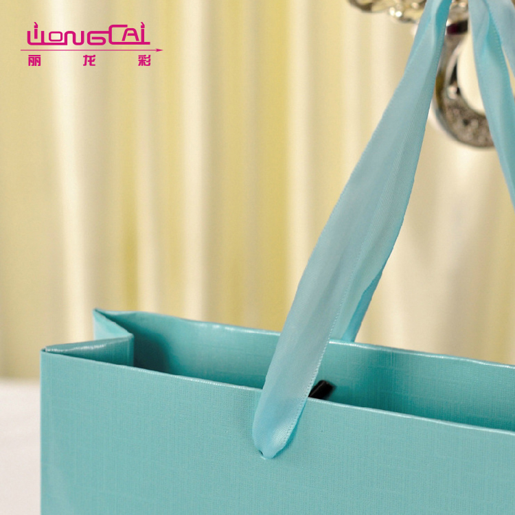 Custom made fancy blue silk handle recycled wedding gift paper bag