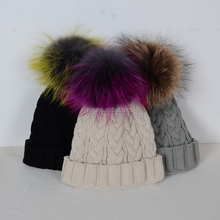 knit winter hat with large raccoon fur pom poms fur ball crochet hats