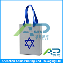 Medium size blue kraft paper bag with silk ribbon handle , wholesale shopping paper bag for X-mas