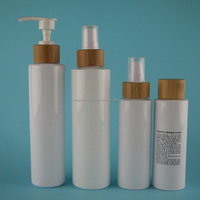 different capacity white PET cosmetic packaging bottle with bamboo dispenser pump
