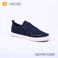 Custom printed brand name men canvas vulcanized rubber sole shoes made in China
