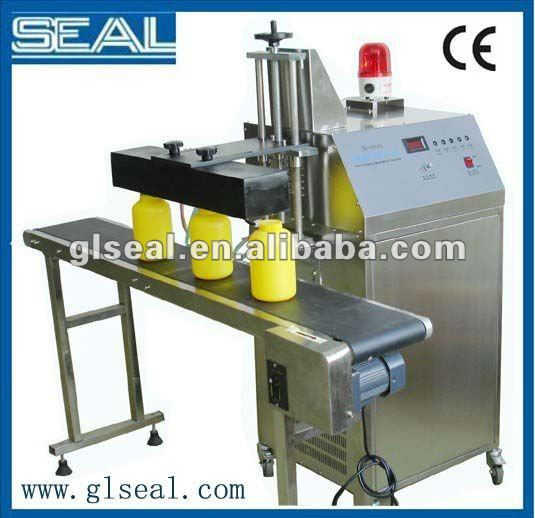 Aluminum foil induction plastic bottle cap sealing manufacture machine