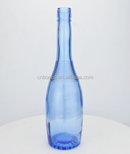 light blue long neck glass tequila bottle