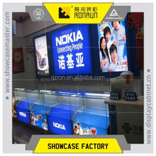Guangzhou top quality mobile phone display counter with logo wall design for shop furniture