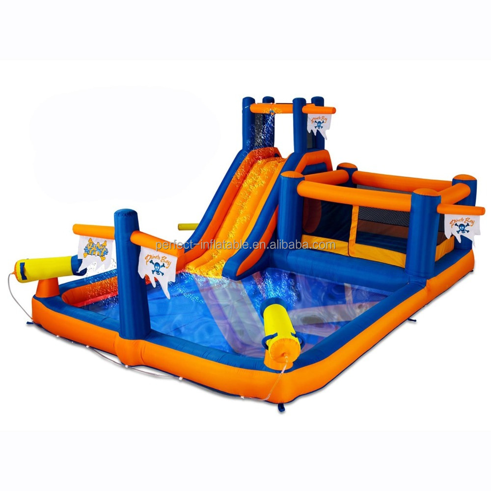 Small plastic Inflatable swimming play pool with a slide for kids in the garden