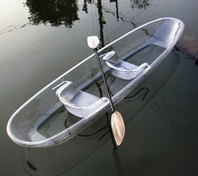 Clear sea kayak with clear paddles