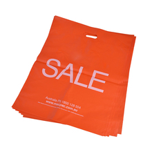 Solid orange OEM logo plastic die cut bag handle