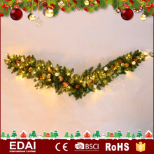 Cheap personalized christmas green wreath ornaments PVC wholesale artificial flower garland