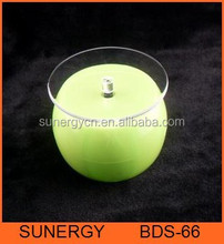 Green Solar and battery powered rotating display stand for bottle
