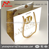 Factory wholesale custom printed gold paper gift bag