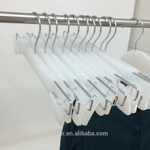 Transparent White Plastic Hanger, with solid plastic clips for pants display