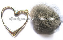 rotatable heart shaped silver coloured bag hanger with rabbit hair ball