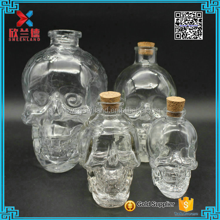 DIfferent size can offer Food safety skull head glass juice <strong>bottle</strong> with cork