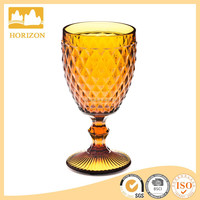 Diamond grain amber colored stemed embossed red wine glass wholesale