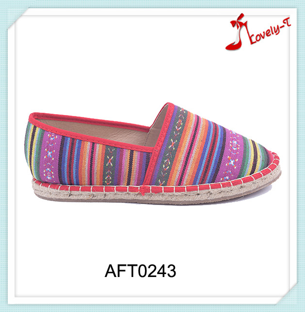 Straw insole latest design hot selling lady cheap flat feet canvas shoes