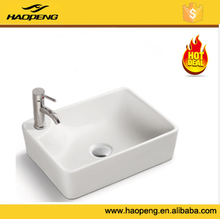 Ceramic toilet wash hand basin , above counter mounting , simple hand basin