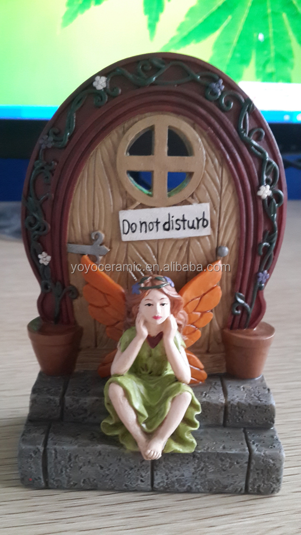 Cute fairy sitting on doorstep floral door Miniature Garden