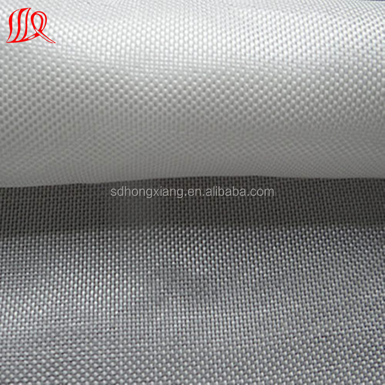 Woven warp knitted geotextile fabric construction