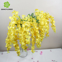 Making artificial dancing orchid silk flowers standing for wedding