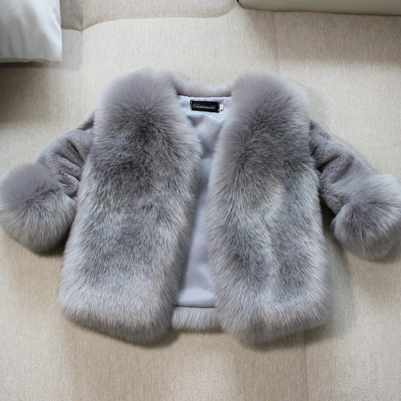 The new children imitated the fox fur coat for girl