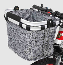 Movable bicycle front basket
