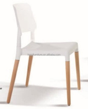 Cheap price elegant plastic dining chair with solid beech wood legs / PP chair
